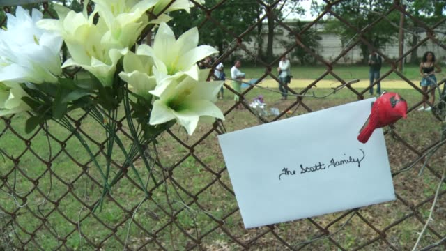 The scene where Walter Scott was shot while running away from a policeman has been turned into a makeshift memorial
