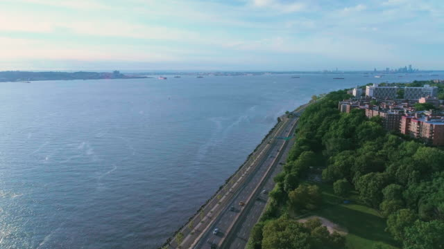 The scenic aerial view toward Manhattan over Brooklyn, Hudson River and Belt Parkway, New York, USA