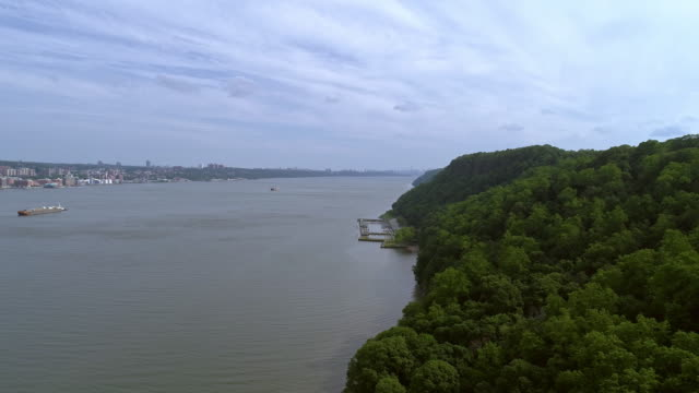 The scenic view along the Hudson River with remote view of Manhattan at the horizon. Palisades Interstate Park, New Jersey.Aerial drone video, slow flight forward.