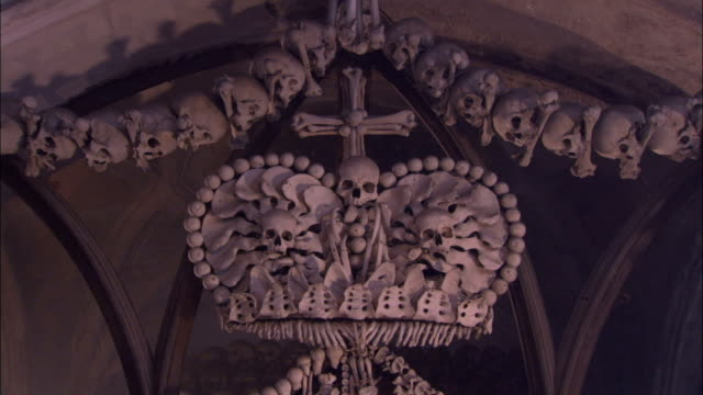 The Schwarsenberg family coat-of-arms made entirely of human bones hangs from the ceiling. Available in HD.