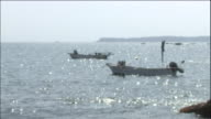 The sea/ divers on a boat: Zoom out/ Long shot