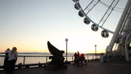 The Seattle Waterfront at sunset during the summer season.