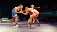 The second day of 2015 Freestyle Wrestling World Cup is held in Los Angeles on April 12 2015 Iran's Hassan Yazdani faces Zhan Safyan of Belarus and...