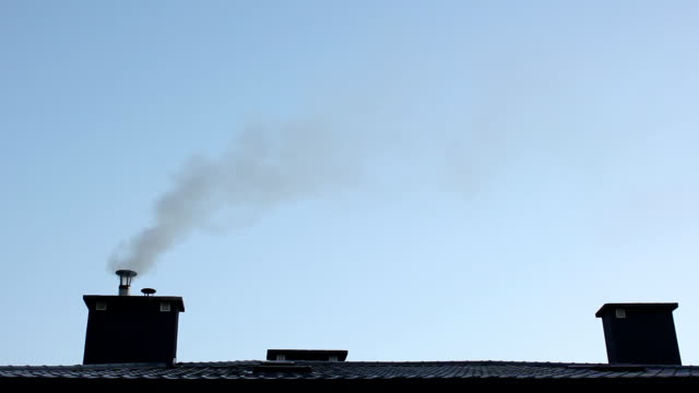 The smoking chimney