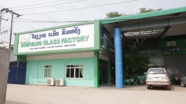 The Somvang Glass Factory stands on the outskirts of Vientiane Laos on Wednesday Nov 1 Signage is displayed at the Somvang Glass Factory Pan left to...