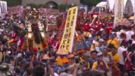 The sound of clanging cymbals and blaring horns filled downtown Taipei on Sunday as thousands marched in a colourful Taoist procession protesting a...