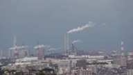 The Space World theme park operated by Space World Inc far right stands in Kitakyushu Japan on Thursday March 2 Smoke rises from the stacks at Nippon...