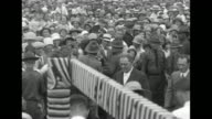 VS 'The Spirit of St Louis' lands on airfield / aviator Charles Lindbergh walks through crowd with Concord NH Mayor Fred Marden to outdoor stage /...