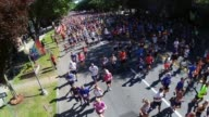 The starting gun sounds and thousands of runners head out from the start The Firecracker 4 on July 4th in Saratoga Springs