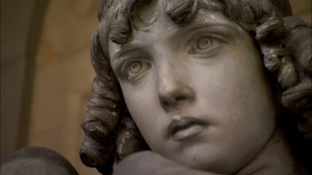 The statue of an angel in the Memorial Colonnade at Genoa's Monumental Cemetery of Staglieno. Available in HD.
