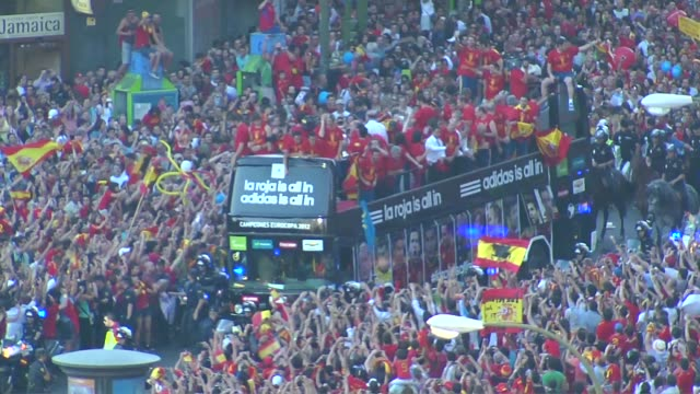 The streets of Madrid are packed to welcome home the victorious Spanish national team who are celebrating after thumping Italy 40 in the European Cup...