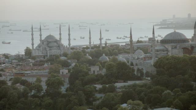 AERIAL The Sultan Ahmet Mosque and the Hagia Sophia overlooking the Bosphorus Strait / Istanbul, Turkey