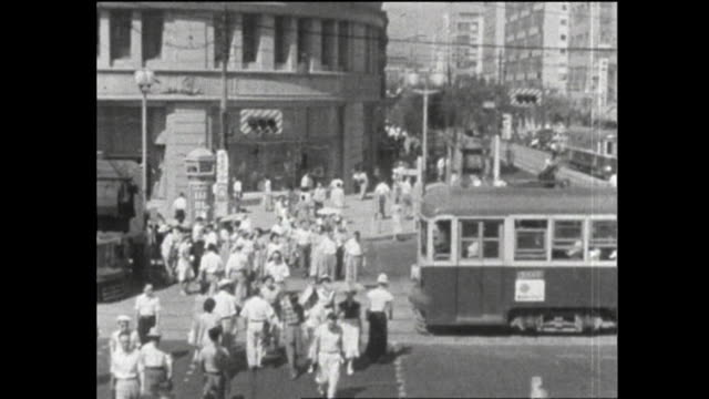 The summer of 1953 Hot latesummer day with temperature over 30 degrees C Passersby wiping sweat off with their handkerchiefs at the intersection in...