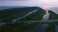 The sun casts a pink hue on the waters of the Gulf Islands National Seashore.