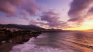 T/L The sun is rising on Costa Del Sol's Nerja and on the Mediterranean Sea / Nerja, Malaga, Spain