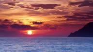 T/L LS The sun is setting over the Liguria Sea and the Cinque Terre Mountains / Riomaggiore, La Spezia, Italy