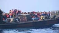 'The Sun Military Awards Ceremony 2016' 862015 / T08061522 MEDITERRANEAN Soliders in boat from HMS Bulwark alongside migrant boat