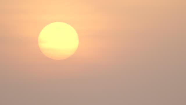 The sun rises slowly over Tanzania.