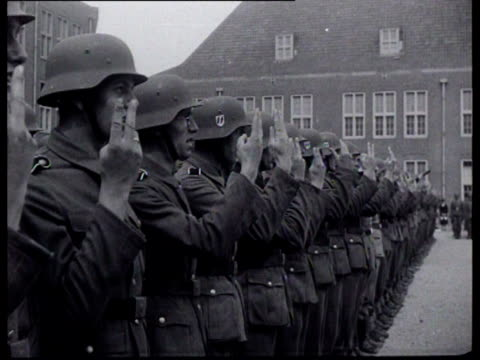 The swearingin of the first battalion of the Dutch Landwacht Mussert SeyssInquart and Rauter give speeches