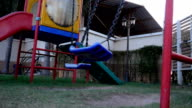 The swing on kid play yard on slow motion footage