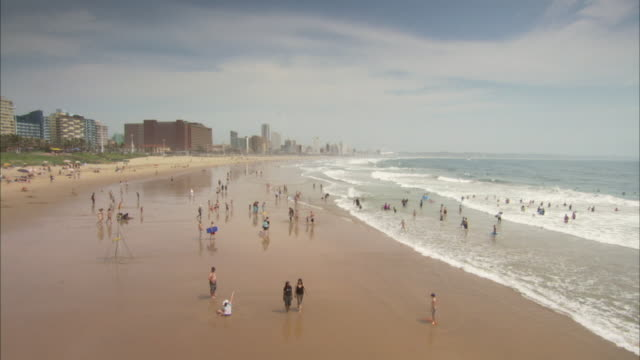 The tide washes up on a beach in Durban, South Africa. Available in HD