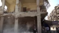 The toll in Syrian government air strikes on a rebel held town outside Damascus neared 100 Monday as the UNs humanitarian chief expressed horror and...