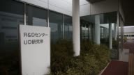 The Toto Ltd logo is displayed outside the Toto research and development center in Chigasaki Kanagawa Japan on Tuesday Feb 14 A researcher wearing...