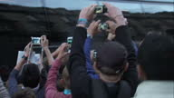 The Tour de France to finish in Paris with Chris Froome wearing the yellow jersey Shows exterior shots fans gathered outside the Team Sky bus after...