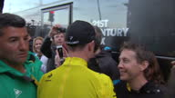 The Tour de France to finish in Paris with Chris Froome wearing the yellow jersey Shows exterior shots Chris Froome being greeted by team members...
