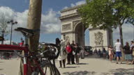 The Tour de France to finish in Paris with Chris Froome wearing the yellow jersey Shows exterior shots the Arc de Triomphe people shopping at Tour de...