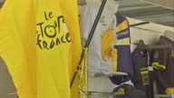 The Tour de France to finish in Paris with Chris Froome wearing the yellow jersey Shows exterior shots official Tour de France boutique selling...