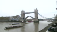 The Tower Bridge opens as a barge carries the Eurostar along the Thames River during the Tenth Anniversary of the Opening of Eurostar