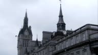 The Town House on Union Street features a clock tower in Aberdeen, Scotland. Available in HD.