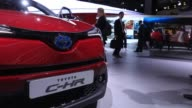 The Toyota Motor Corp logo sits illuminated on the automaker's exhibition area during the second media preview day of the IAA Frankfurt Motor Show in...