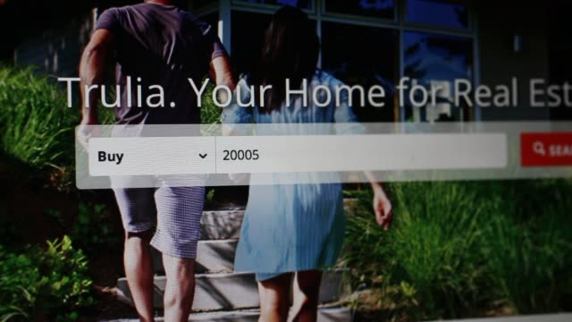 The Trulia Inc website is arranged for a photograph in Washington DC Close up shots of a mouse cursor clicking through the Trulia website and...