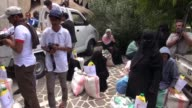 The UAE Red Crescent Society delivers food aid to families in Taez in Yemens southwest where a loyalist garrison has been under rebel siege for months