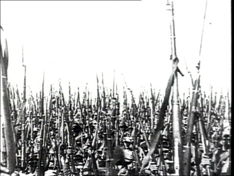 MONTAGE 'The victory' Soldiers holding rifles in victory sign Red Army troops leave on barge soldiers wave from boat Flags chimneys w/ smoke