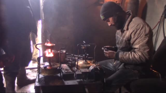 The video shot in Idlib Syria displays Syrians repairing gas cookers in repair shops in Idlib Syria on January 27 2015 Syrians have started to use...