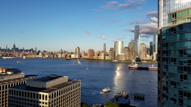 The view of the Manhattan from New Jersey, over the Hudson River, before a sunset. Mobile video.