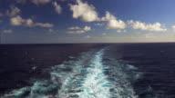 The wake of a large cruise ship as it cruises in the Pacific Ocean off the Hawaiian island of Kauai