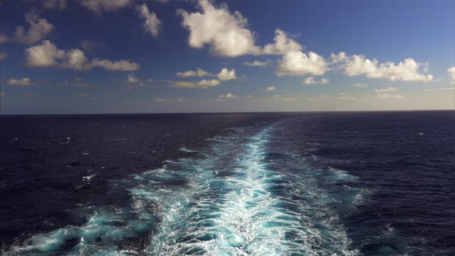The wake of a large cruise ship as it cruises in the Pacific Ocean off the Hawaiian island of Kauai