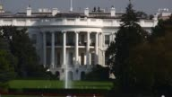 The White House stands past the South Lawn as dark clouds pass over it in Washington DC US