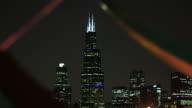 The Willis Tower At Night As Seen Through An Outdoor Sculpture