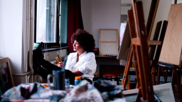The woman artist seeks inspiration