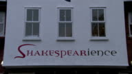The word Shakespearience decorates the awning of a store. Available in HD.