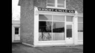 The Wright brothers bicycle shop on 4th street in Dayton Ohio / interior of shop and narrator explains how Wright brothers explored ideas of Sir...