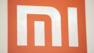 The Xiaomi Corp logo is displayed behind a reception desk at the companys headquarters in Beijing China on Friday Sept 12 Pull focus into and out of...