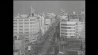 The yearend of 1953 Famous intersection called Ginza 4 Chome A look of clearance sale for Christmas and yearend Disabled veterans carrying on...