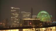 The Yokohama Harbor reflects lights from the Minato Mirai 21 area in Japan.