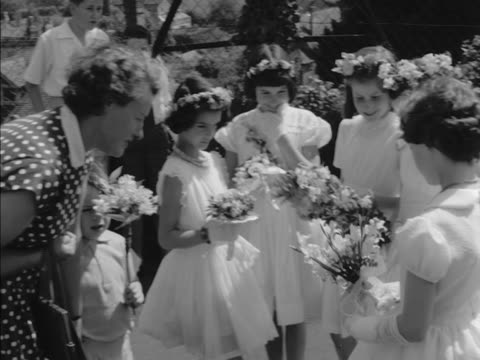 The young attendants of the Lustleigh May Queen carry floral posies